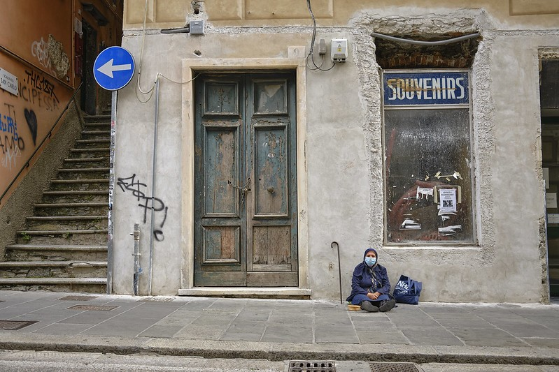 A panhandler in Genoa, Italy during lockdown.